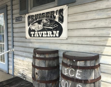 two barrels with a business sign above