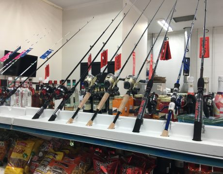 fishing poles on display at the bait store