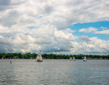 4 sail boats on the water