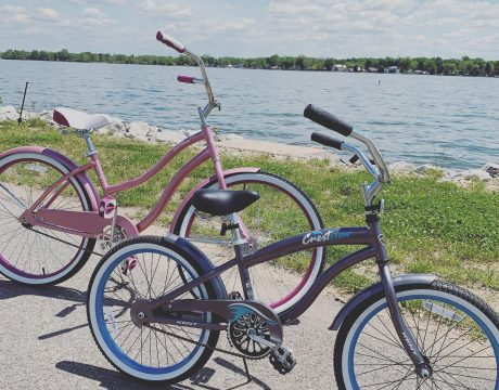 two kids bicycles by lake