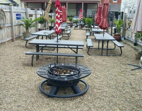outdoor patio with tables and firepit