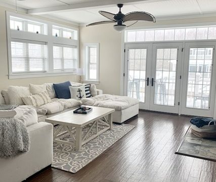 white sectional 2 ceiling fans