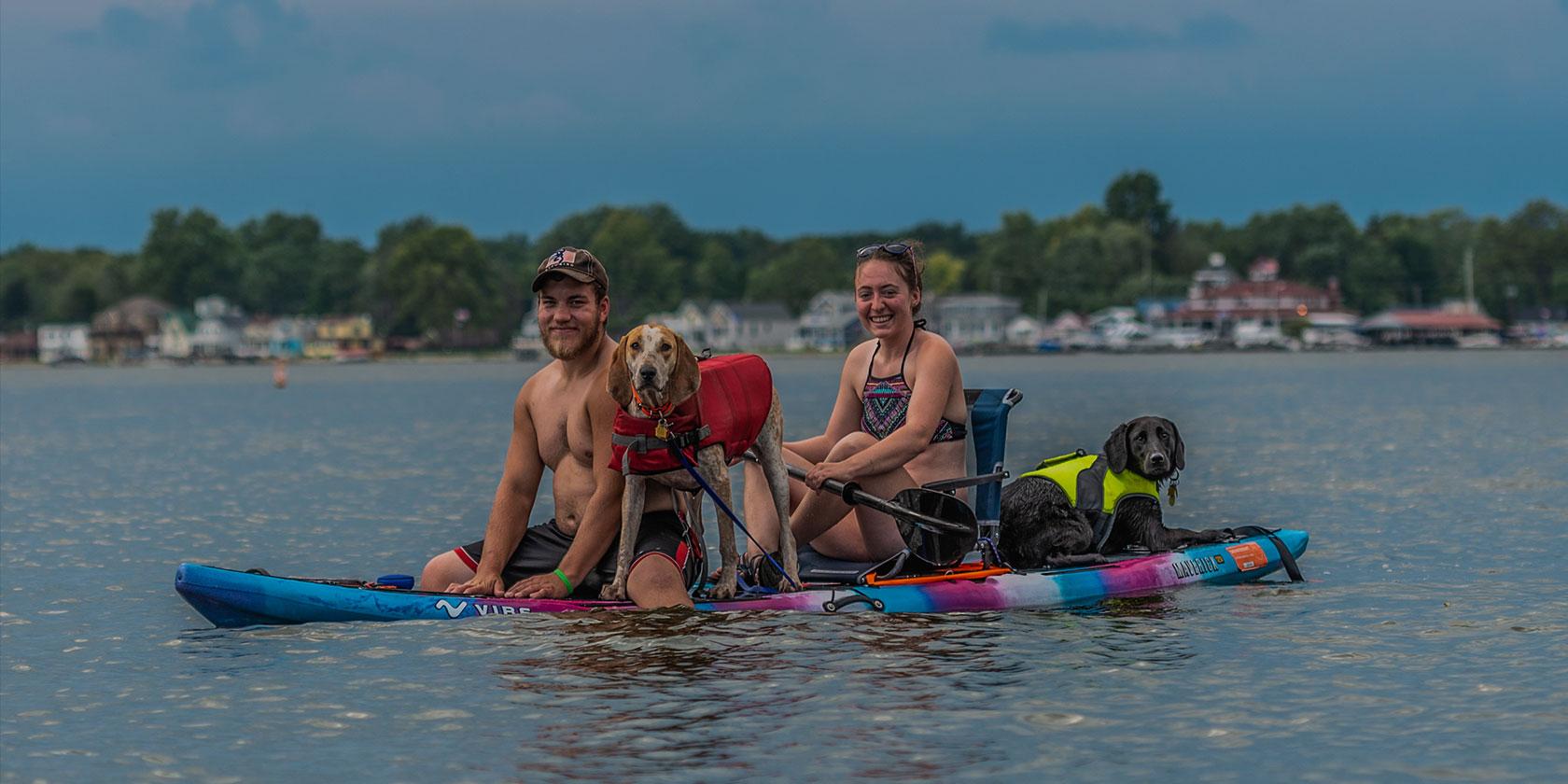 Couple and dog on a kayak