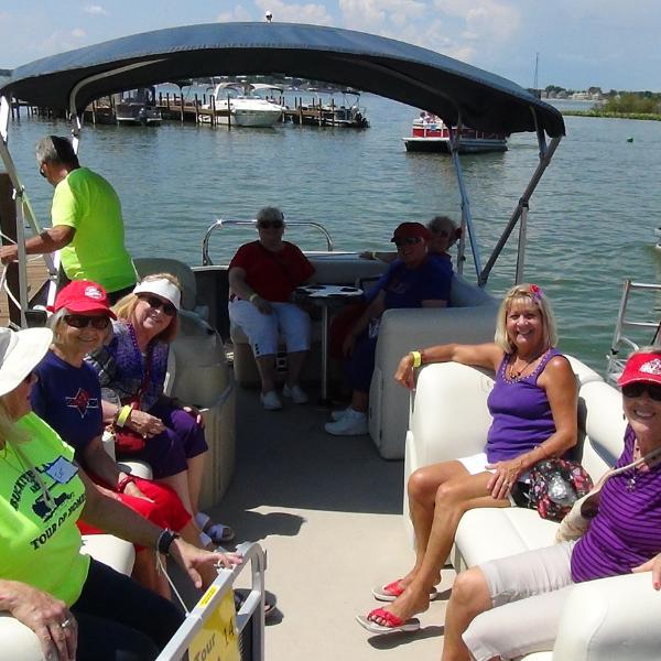 ladies on a pontoon boat