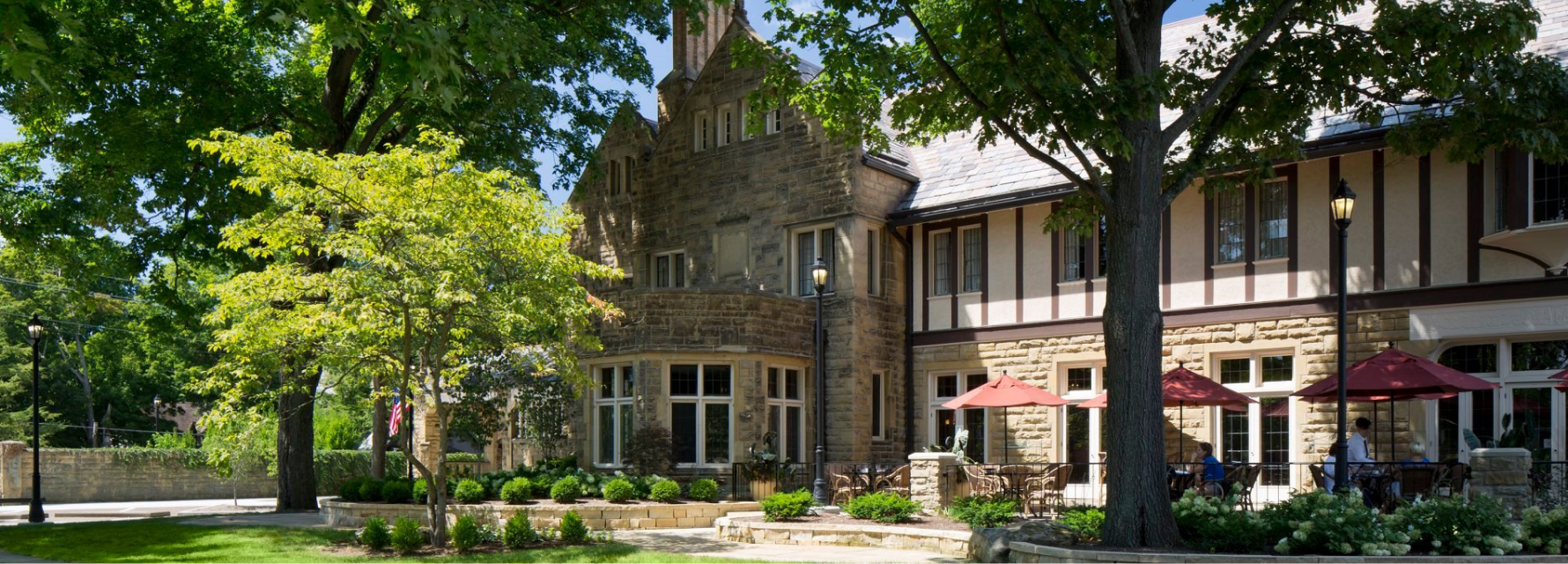 stone hotel with outdoor dining