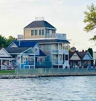 yellow home on the lake