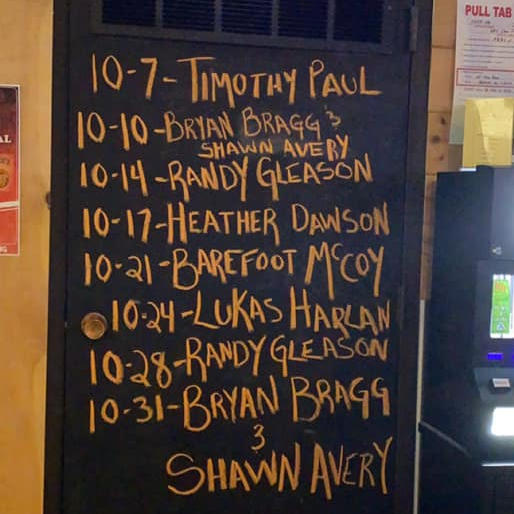 A chalkboard with New Dam Pub's October lineup.